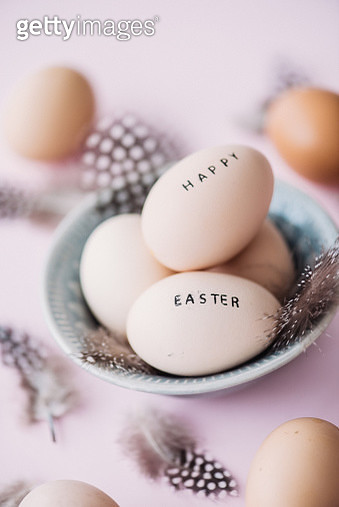 Happy easter eggs with feathers and text - gettyimageskorea