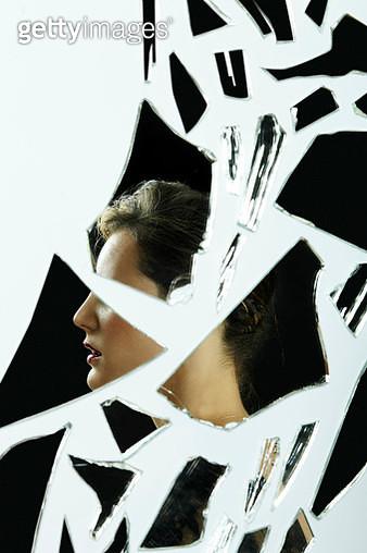 Abstract profile portrait of lady in broken glass - gettyimageskorea