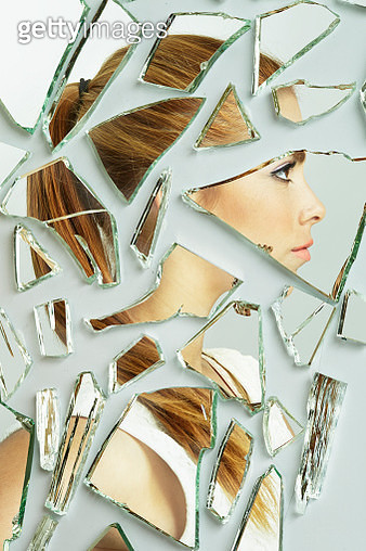 Side profile of a young lady in broken mirrors - gettyimageskorea