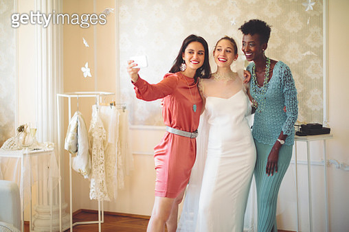 The bride is trying on her wedding dress - gettyimageskorea