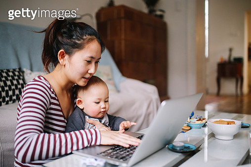 Young Asian mom trying to work with her baby boy - gettyimageskorea