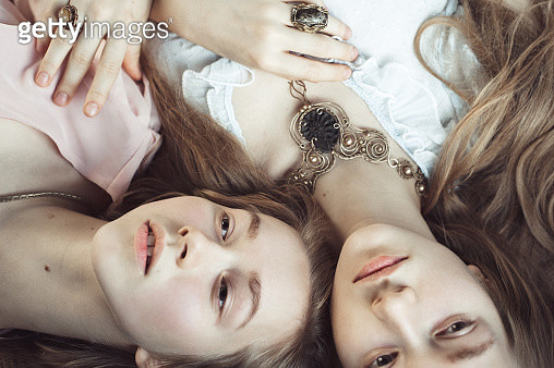 Portrait  of  two women on the bed - gettyimageskorea