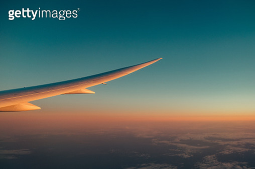 Cropped Airplane Wing Against Blue Sky - gettyimageskorea