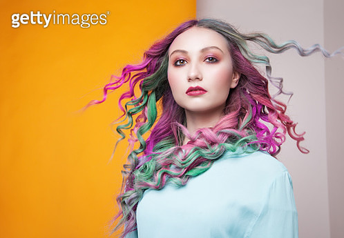 Model with colored waving hair in studio - gettyimageskorea