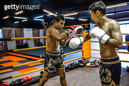 Muay Thai match on boxing ring in Thailand - gettyimageskorea
