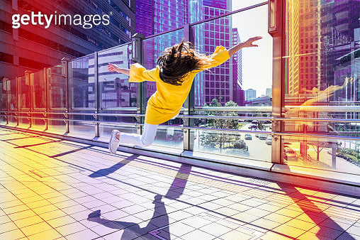 Woman floating in the city - gettyimageskorea