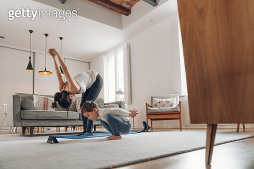 Mother with children doing Yoga at home - gettyimageskorea