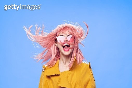 Bright and fashionable teenager girl Hipster with pink dyed hair with bright accessories and bright makeup screams in delight. - gettyimageskorea