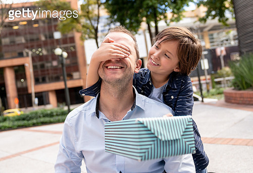 Boy surprising his father with a gift for Father's Day - gettyimageskorea