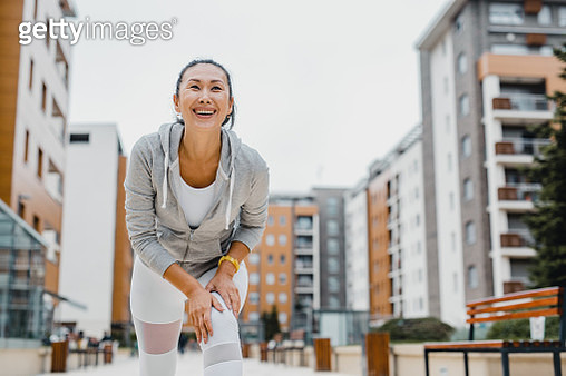 Asian mid adult woman doing sport outdoors - gettyimageskorea