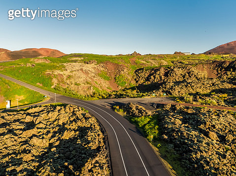 Empty road, lava and moss, Westman Islands, Iceland - gettyimageskorea