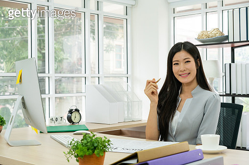 Profile side view photo of intelligent stylish boss in a gray checkered jacket sitting in office chair in workstation on industrial style half a turn with a tablet in hand - gettyimageskorea