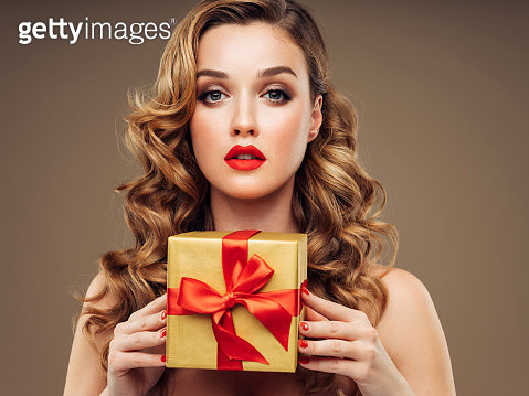Happy woman with a gift - gettyimageskorea