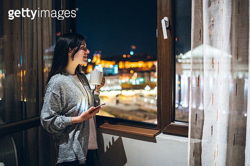 Drinking coffee and chatting at window - gettyimageskorea