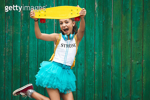 Happy and fun beautiful girl jumping with skateboard - gettyimageskorea