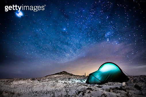 Illuminated Tent On Snow Covered Field At Night - gettyimageskorea