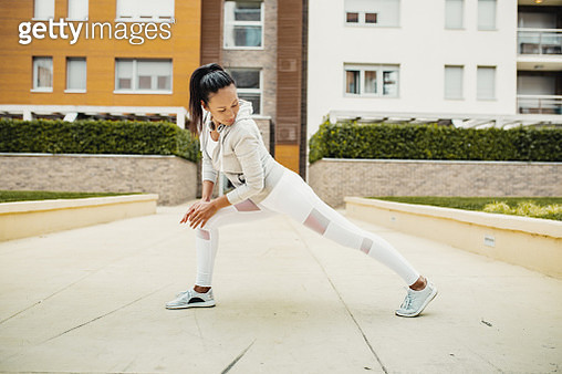Asian woman doing exercise outdoors in the city - gettyimageskorea
