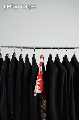 Hawaiian shirt hanging between black blazers - gettyimageskorea