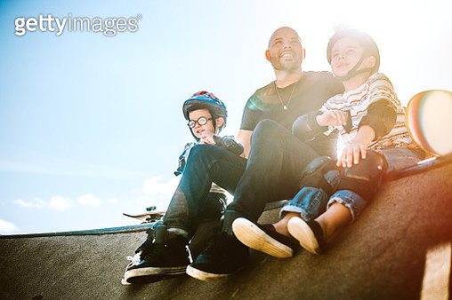 Father and Sons Skateboarding - gettyimageskorea