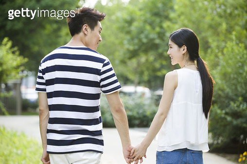 Happy young couple holding hands - gettyimageskorea