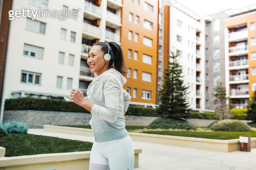 Asian woman doing exercise outdoors - gettyimageskorea