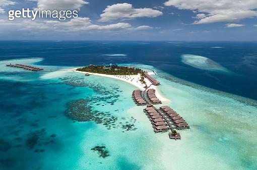 Aerial View Of Sea Against Blue Sky - gettyimageskorea