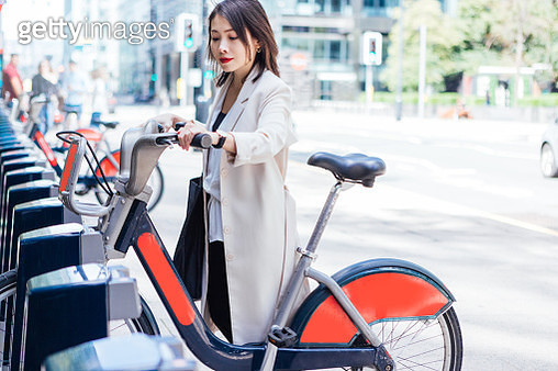 Business Woman Commuting To Work By Bicycle - gettyimageskorea
