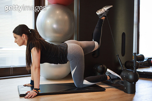 Beautiful woman exercising in  the gym - gettyimageskorea