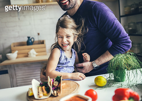 Father And Daughter In Kitchen At Home Making tortillas - gettyimageskorea