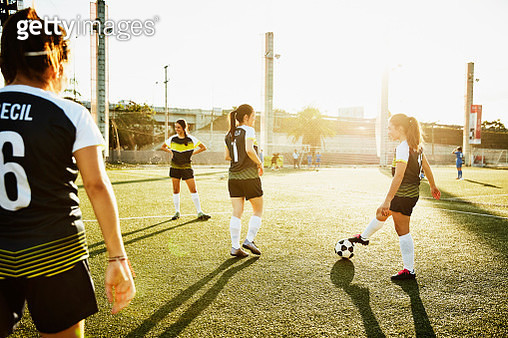 Female soccer teammates warming up on field before game - gettyimageskorea