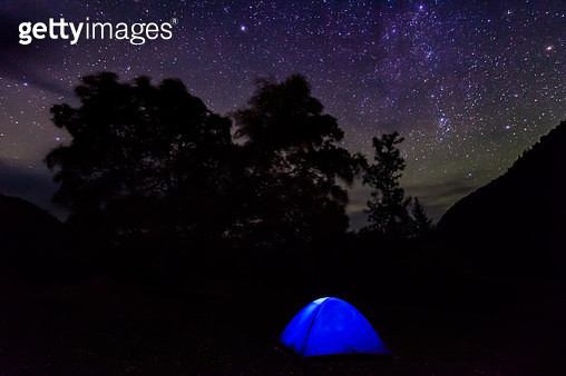 Illuminated tent against the starry sky - gettyimageskorea