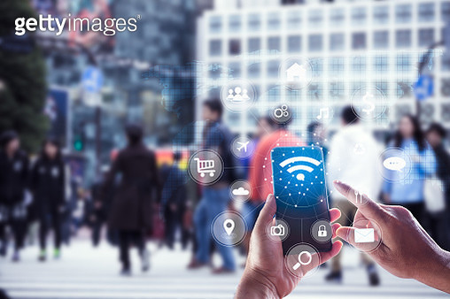 Touching social icon on screen connect internet and network all device technology with city background of business in blue tone, business and technology concept - gettyimageskorea