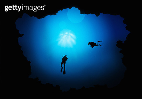 Low Angle View Of Silhouette People Swimming In Sea - gettyimageskorea