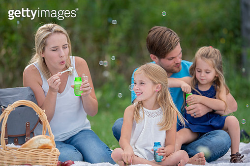 Family blowing bubbles - gettyimageskorea