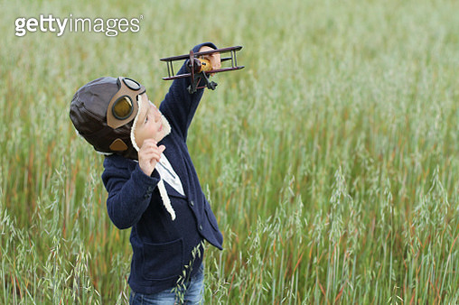Little boy playing with wooden toy airplane - gettyimageskorea