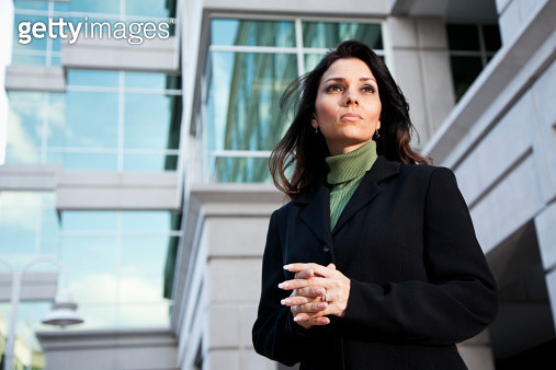 Businesswoman standing outside office building - gettyimageskorea