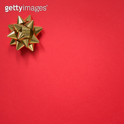 Gold bow on christmas red background - gettyimageskorea