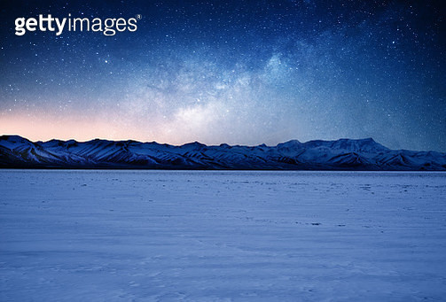 The Milky Way Over the Snow Mountains of Tibet - gettyimageskorea