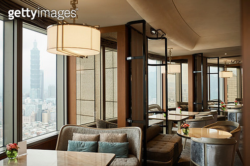 Empty chairs and tables in restaurant at hotel - gettyimageskorea