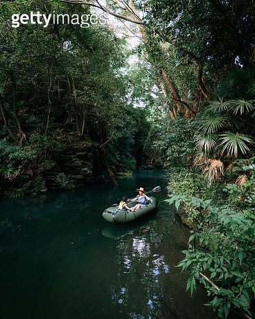 Mother and child exploring rainforest river by kayak, Saitama, Japan - gettyimageskorea