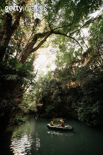 Father and child kayaking on river in rainforest, Japan - gettyimageskorea