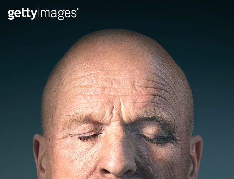 Studio photograph of middle-aged man's head with eyes closed. - gettyimageskorea