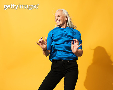 Portrait of mature woman dancing, smiling and having fun - gettyimageskorea