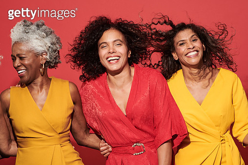 Portrait of a group of mature women against a red background - gettyimageskorea