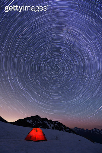 Red tent and Star Trails on snow mountain - gettyimageskorea