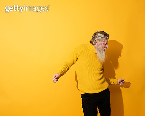 Portrait of mature man dancing and having fun - gettyimageskorea