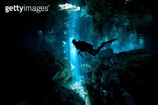 Scuba diver inside cenote in Mexico - gettyimageskorea