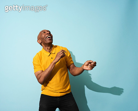 Portrait of a mature man dancing, smiling and having fun - gettyimageskorea