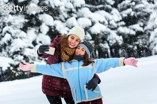 Two girl taking a selfie - gettyimageskorea
