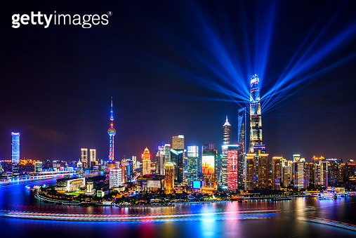 Shanghai skyline at night with spotlights - gettyimageskorea